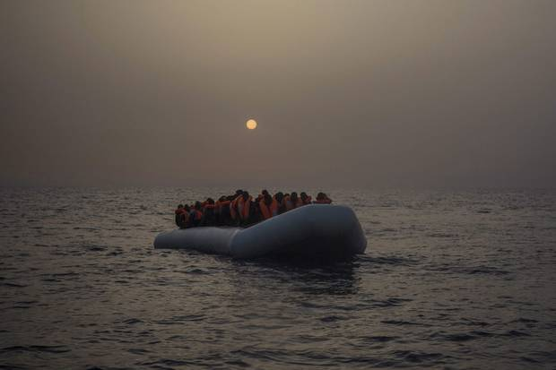 African migrants, mostly from Sudan and Senegal, wait on an out-of-control rubber boat to be assited by an NGO-run rescue ship north of Sabratha, off the Libyan coast, on Feb. 23, 2017.