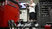 Vancouver Canucks Equipment Manager Pat O'Neill sharpens skates after a team practice at Rogers Arena April 10, 2012 in Vancouver, British Columbia, Canada. (Jeff Vinnick/The Globe and Mail)