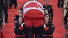 Pallbearers carry the casket of Const. Jennifer Kovach at her funeral in Guelph, Ont., on Thursday, March 21, 2013. Kovach, 26, died a week ago today when her cruiser crossed the centre line and collided with a Guelph Transit bus. (Nathan Denette/THE CANADIAN PRESS)