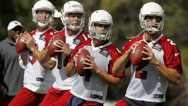 From left to right, Arizona Cardinals quarterbacks John Skelton, Ryan Lindley, Kevin Kolb, and Richard Bartel drop back to throw passes during the first day of NFL training camp football practice at Northern Arizona University, Wednesday, July 25, 2012, in Flagstaff, Ariz. (Ross D. Franklin/AP)