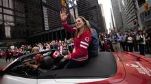 Olympic gold medalist Rosie MacLennan waves to crowds along Bay Street in Toronto during a parade celebrating Canada's Olympic athletes Sep 21, 2012. (Moe Doiron/The Globe and Mail)