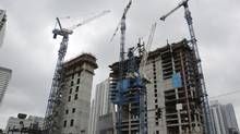 Cranes hover over the Brickell CityCentre construction site located in the centre of the Brickell financial district in downtown Miami. (Lynne Sladky/AP)