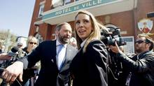 Ruth Ellen Brosseau, the NDP MP for the riding of Berthier-Maskionge, leaves city hall in Louiseville, Que., on May 11, 2011, with deputy leader Thomas Mulcair. (Graham Hughes/THE CANADIAN PRESS)