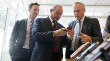 From left, Anthony Lacavera, chairman of Wind Mobile; Naguib Sawiris, head of Orascom Telecom; and Ken Campbell, CEO of Wind Mobile (1--Sarah Dea/2--Sarah Dea/The Globe and Mai)