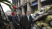 Canada's Foreign Affairs Minister John Baird walks past a barricade at Independence Square in Kiev, February 28, 2014. (Valentyn Ogirenko/REUTERS)