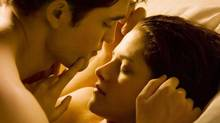 "Robert Pattinson and Kristen Stewart star as Edward and Bella in ""The Twilight Saga: Breaking Dawn, Part 1"". (Reuters)"