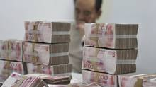 To many Chinese, making the yuan into a major international currency is the next step in confirming the country's new status as an economic and diplomatic power. (Sheng Li/Reuters/Sheng Li/Reuters)