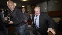 Toronto Mayor Rob Ford is followed by a crush of media as he returns to his office March 19, 2014. An Ontario judge released more documents related to Project Brazen 2. ((Fred Lum/The Globe and Mail)