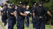 A Police search team  prepares to enter the woods at Hewick Meadows Park in Mississuaga, Thursday August 16, 2012 after body parts were discovered. (Chris Young/The Globe and Mail)