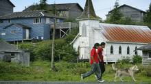 Two young natives walk along a road in the remote community of Ahousaht July 8, 2005 which is dealing with an epidemic of suicides and is calling for professional help. (John Lehmann/The Globe and Mail/John Lehmann/The Globe and Mail)