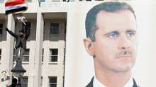 A giant portrait of embattled Syrian President Bashar al-Assad hangs on a building in the capital Damascus on November 28, 2011. (LOUAI BESHARA/AFP/Getty Images)