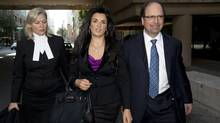 Tali'ah Aquilini, centre, leaves B.C. Supreme Court in downtown Vancouver on Sept., 9, 2013. (Jonathan Hayward/The Canadian Press)