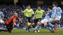 Manchester City's David Silva (3rd R) shoots past Aston Villa's Brad Guzan (2nd L) to score during their English Premier League match at The Etihad Stadium in Manchester, northern England November 17, 2012. (PHIL NOBLE/REUTERS)