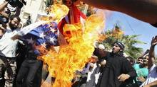 Members of the Islamist Salafis set fire to a U.S. flag during a demonstration against a film produced in the U.S. that they said was insulting to Prophet Mohammad in Amman (Muhammed Hamed/Reuters)