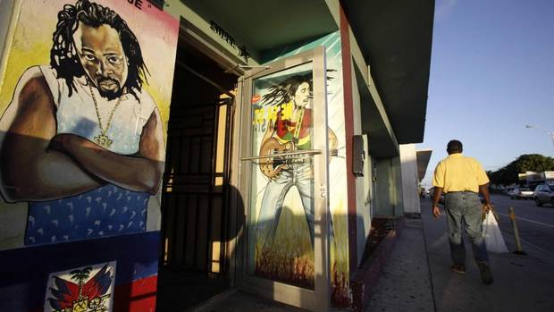 Murals by artist Serge Toussaint are common on the streets of Little Haiti. (LYNNE SLADKY/AP)