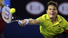 Canada's Milos Raonic hits a return to Australia's Lleyton Hewitt during their third round match at the Australian Open tennis championship, in Melbourne, Australia, Saturday, Jan. 21, 2012. (Andrew Brownbill/The Associated Press/Andrew Brownbill/The Associated Press)
