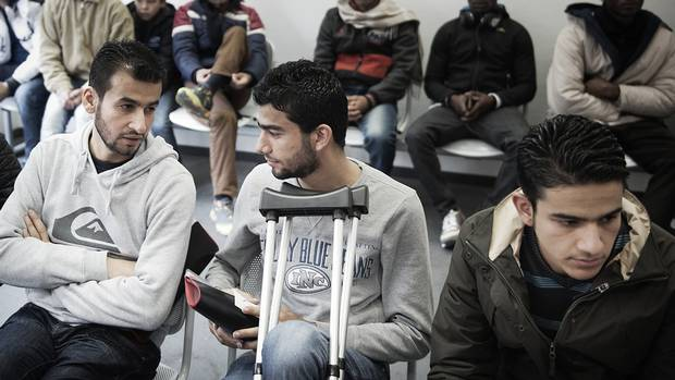 Basel Omran, Osama Omran and Zain Al Abedin Omran nervously await the initial interview in their asylum process.