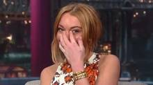 "Lindsay Lohan sheds a tear in a screen grab from a YouTube video of her interview with on ""Late Show with David Letterman"" on April 9, 2013."