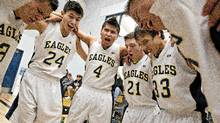 The Ermineskin Eagles have a team chant to start their game against the Ryley Rebels in Hobbema, Alberta on March 16, 2012. (Jason Franson for The Globe and Mail/Jason Franson for The Globe and Mail)