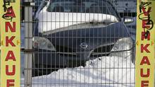 Cars are parked at a dealer in Berlin's Weissensee district March 26, 2013. New car sales have dropped 10 per cent in 2013 so far this year in Germany, nearly 30 per cent in the Netherlands and 14.8 per cent in Sweden. (TOBIAS SCHWARZ/REUTERS)