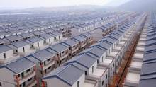 A general view shows newly built houses at Dadun village of Lingshui ethnic Li Autonomous County, Hainan province, in this January 18, 2013 file photo. (STRINGER/CHINA/REUTERS)