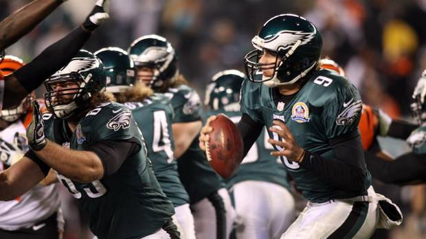 Philadelphia Eagles quarterback Nick Foles tries to avoid pressure from Cincinnati defenders during the fourth quarter. The Philadelphia Eagles fell to the Cincinnati Bengals 34-13 at Lincoln Financial Field Thursday, Dec. 13, 2012. (DANIEL SATO/The News Journal/AP)