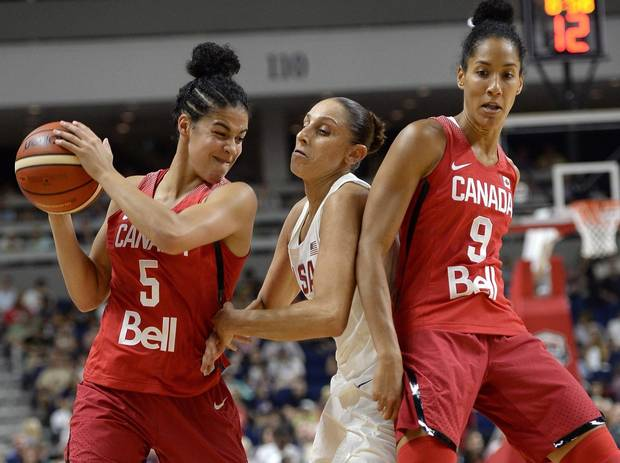 Canada's Kia Nurse, left, keeps the ball from United States' Diana Taurasi, center, as Canada's Miranda Ayim, right, defends, during the first half of an exhibition basketball game, Friday, July 29, 2016, in Bridgeport, Conn. The Canadian women's basketball team has plenty of momentum heading into the Rio Olympics.