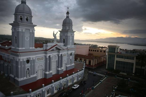 The sun sets behind the Cathedral of Our Lady of the Assumption in Santiago de Cuba.