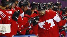 Canada's Drew Doughty, right, celebrates his first goal against Finland with teammates during the first period of their men's preliminary round ice hockey game at the 2014 Sochi Winter Olympic Games, Feb. 16, 2014. (MARK BLINCH/REUTERS)