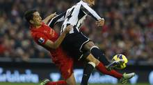 Liverpool's Nuri Sahin (L) challenges Newcastle United's James Perch during their English Premier League match at Anfield in Liverpool, northern England, November 4, 2012. (PHIL NOBLE/REUTERS)