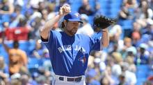 Toronto Blue Jays starting pitcher R.A. Dickey reacts after allowing a solo single home run against the Seattle Mariners during first inning AL baseball action in Toronto on Saturday, May 4, 2013. (Nathan Denette/THE CANADIAN PRESS)