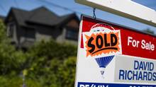 A sold sign on a property in Vancouver's Kitsilano neighbourhood June 9, 2013. (Rafal Gerszak For The Globe and Mail)