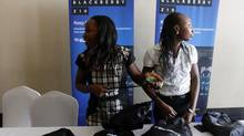 Women stand at a reception table during the launch of the new BlackBerry Z10 smartphone in Lagos March 7, 2013. (AKINTUNDE AKINLEYE/REUTERS)