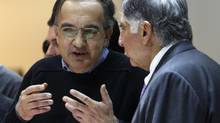 Sergio Marchionne, left, CEO of both Fiat and Chrysler, has long wanted to merge the two auto makers but has said he would be open to an IPO. (DENIS BALIBOUSE/REUTERS)