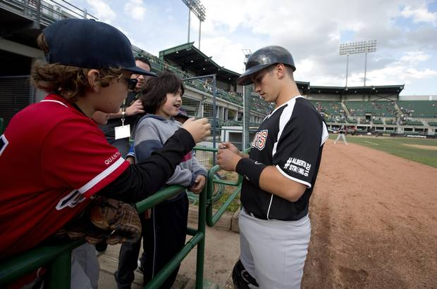 Fort McMurray Giants' Josh Iannetti signs autographs for fans before taking on the Edmonton Prospects in Edmonton on May 28, 2016. It's the Giants first game in their borrowed stadium since the wildfires in Fort McMurray.