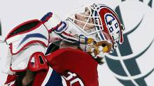 Montreal Canadiens goalie Peter Budaj (30) celebrates his shutout win against Carolina Hurricanes during third period NHL hockey action in Montreal, February 18, 2013. (Reuters)