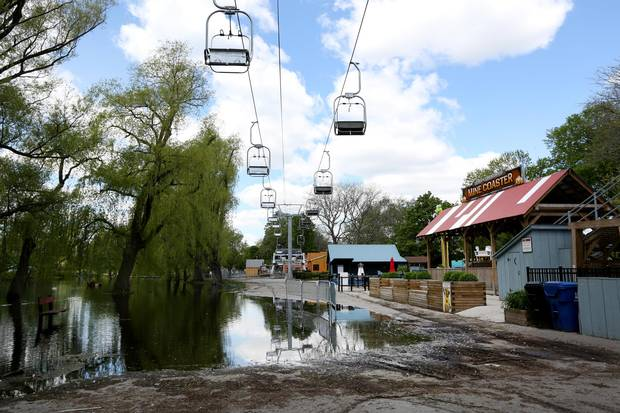 Centre Island's amusement park is empty, closed because of the flooding.
