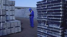 A workman checks zinc bars ready for dispatch at Xstrata's San Juan de Nieva refinery in Spain in this file photo.