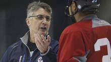 Winnipeg Jets head coach Claude Noel talks to Dustin Byfuglien (33) on day three of training camp in Winnipeg on Tuesday, January 15, 2013. (The Canadian Press)