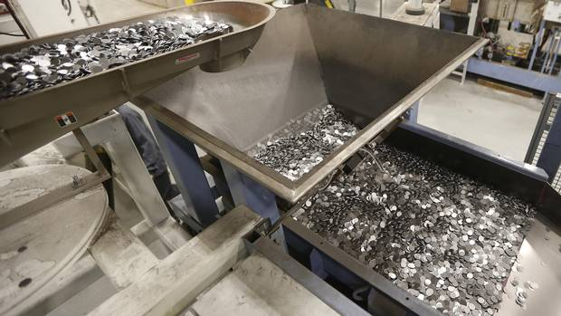 Blanks enter an oven to heated to 800 degree celsius to anneal the metal at the Royal Canadian Mint in Winnipeg Tuesday, April 4, 2017.