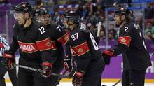 Canada's Patrick Marleau, Jeff Carter, Sidney Crosby and Duncan Keith (from L) skate off after Carter scored on Austria during the second period of their men's preliminary round ice hockey game at the Sochi 2014 Winter Olympic Games, February 14, 2014. (MARK BLINCH/REUTERS)