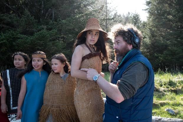 Director Gwaai Edenshaw (righy) on set in the ancient village of Yan, Haida Gwaii.