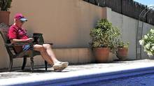 Quintin Jardine e-reads by the pool in Spain. (Eileen Mansfield)