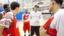 Pat Knight, centre, son of legendary basketball coach Bob Knight, talks to a new crop of players as head coach at Lamar University on Aug. 15, 2011. (CHRIS BOLIN FOR THE GLOBE AND MAIL)