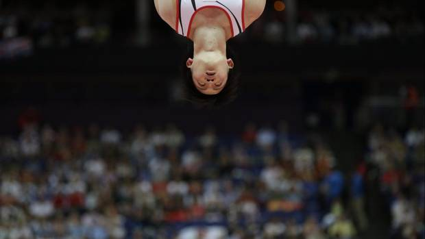 Japanese gymnast Yusuke Tanaka performs on the rings during the Artistic Gymnastic men's team final at the 2012 Summer Olympics, Monday, July 30, 2012, in London. (Julie Jacobson/AP)