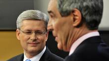 Conservative Leader Stephen Harper, left, and Liberal Leader Michael Ignatieff in the 2011 French-language leaders' debate. (Sean Kilpatrick/Sean Kilpatrick/The Canadian Press)