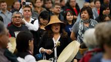 A woman from the Haisla First Nation beats a drum during a ceremony to open hearings for the Enbridge Northern Gateway Project in Kitimaat Village, B.C., on Tuesday January 10, 2012. (THE CANADIAN PRESS/Darryl Dyck/THE CANADIAN PRESS/Darryl Dyck)