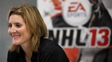 Hayley Wickenheiser, olympic gold medalist hockey player and one of the first two female to be featured in a sports video game, speaks with The Canadian Press before the release of EA Sports' NHL 13 game in Toronto on Tuesday, August 28, 2012. (Michelle Siu/THE CANADIAN PRESS)