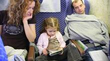 Family in plane (Thinkstock)