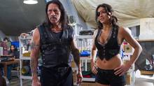 Danny Trejo and Michelle Rodriguez in a scene from Machete Kills. (Rico Torres/AP)